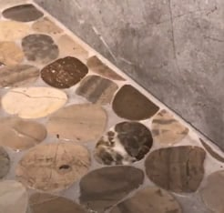 pebble bathroom tile floor